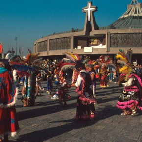 Prehispanic dancers in front of the Basilica in Mexico City for the day of the Virgin of Guadalupe