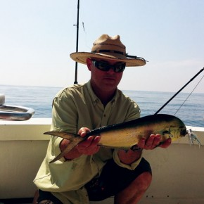 The Author with a fly caught Dorado. Caught under a log 18 miles out.