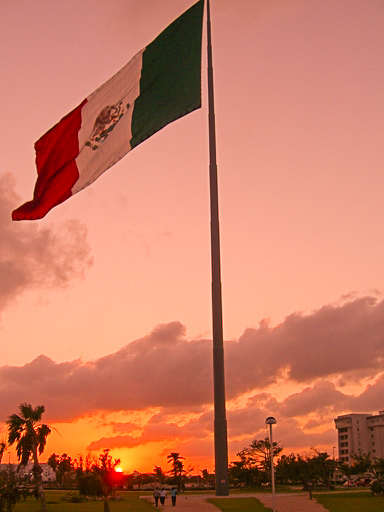 Mexican flag at sunset, Acapulco, Gro.