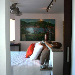 Master Bedroom with painting by local artist, Photo by Marc Pouliot